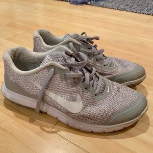 Gray and white Nike sneakers